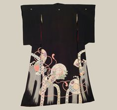 Hikizuri, Late Meiji (1880-1911). A silk Geisha Hikizuri featuring patterns created by yuzen-dyeing, embroidery highlights, and metallic couching.