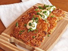 Ramen Latkes...Latkes, made of ramen. How funny...my son was just saying last night we should fry ramen noodles! Now I have a recipe :)