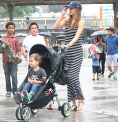 Wait for me! Miranda Kerr, with little man Flynn in tow, looks ahead as husband Orlando Bloom makes a dash to the Yankees Stadium in the Bronx, New York on Monday