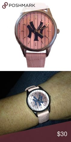 New York Yankees Pink Watch Works Perfectly The New York Yankees Ladies Pink Watch brilliantly showcases the Yankees logo.  The watch has a genuine leather pink band along with a stainless steel casing. It keeps very precise time with the Japanese Quartz Movement that is built into the watch. Game Time Accessories Watches