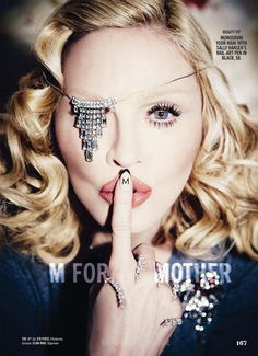 Madonna-Cosmopolitan-2015: Inside the magazine, Madonna has one eye hidden proving, once again, that she is 100% on board the occult elite's agenda. (from vigilantcitizen.com)