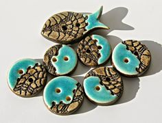 Lovely earthenware clay buttons. You could also make them in polymer clay, though would not get the same lovely effect with the turquoise.