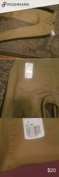 Khaki Skinny Jeans with black line Khaki Skinny Jeans with black line Forever 21 Pants Skinny