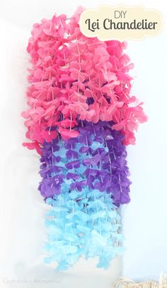 DIY Lei chandelier. Easy party craft! Perfect for luaus, swim party, or just a summer party!