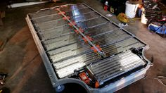 Tesla Motors club user a Tesla model S owner himself, wants to build an awesome solar storage system. He's purchased a battery pack from a salvaged Tesla Model S, and is tearing it d… Tesla Motors, Creme Anti Rides, Tesla Ceo, Nikola Tesla, Golf Cart Batteries, Nissan Leaf, Les Rides, Energy Storage, Limousine