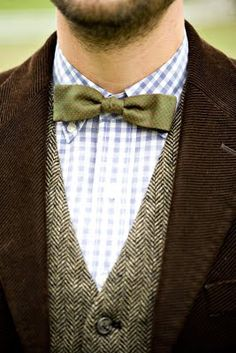 This is everything a bow tie should be.  However, it would look better styled with a spread collar.  Notice how you can see the points and buttons of the polo collar.  Awful.