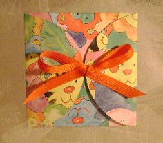 Change to flower scrapbook paper and purple ribbon