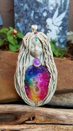 Chakra pixie crystal clay goddess pendant handcrafted by Wakee's Wares on facebook ☺  ✌