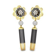 Earrings with tassels and black rhodium finish is  something not so common to find. #Gold #Diamonds #Floral #WhiteGold #Jewellery #Monsoon #Collection #Necklace #FleurCollection #Flowers #Bespoke #Delicate #DailyWear #Solitaires #Chain #Pendant #Rhodium #JewelleryDesign #IndianJewellery #CherryBlossom #Chrysanthemum #SolitairePendant #SolitaireNecklace #FloralNecklace #ForBride #FloralBridalJewellery #FloralWeddingJewellery #BuyOnline