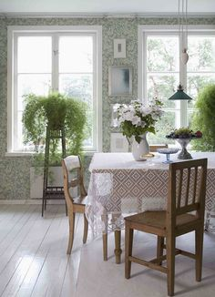 Crisp white floors, beautiful papered walls and rich wood furnishings.
