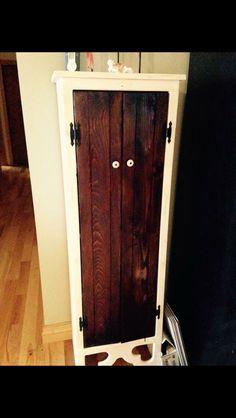Pie cupboard chaulk painted and doors stain in dark walnut.