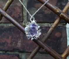 """""""Mome Raths on Ice"""" pendant in silver plate, amethyst, and pearl."""