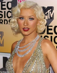 Christina Aguilera. lover her hair and makeup. and dress. and face haha
