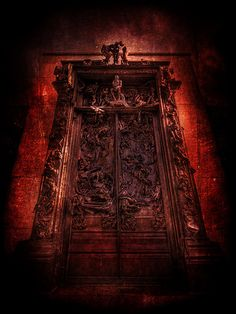 """Dante's Gates of Hell. This is Rodin's huge famous La Porte de l""""Enfer, also known as the Gates of Hell. Musee Rodin in Paris"""