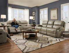 "Softie Putty  Genuine Leather  Motion Sofa and  Console Love Seat Top Grain Italian Leather Match by Corinthian   Reclining Sofa  and Console Love Seat   $2399.00    Sofa W90"" D42"" H40""  Love Seat W79"" D42"" H40""   OAK 68001"