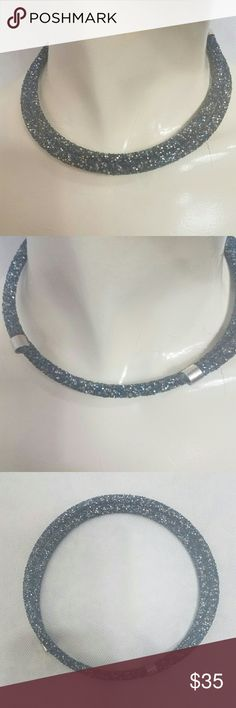 Swarovski choker Beautiful Swarovski elements with shimmer of black and blues. Better in person Swarovski Jewelry Necklaces