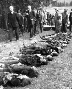 German civilians are forced to walk past bodies of 30 Jewish women, starved to death by German SS troops.