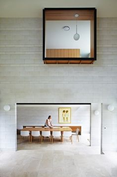 Clayfield House  The double-height living spaces looks through the dining space. Artwork: John Maitland.