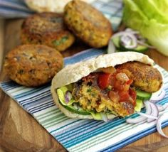 Falafel burgers whole wheat pita stuffed with falafel, cabbage slaw and TZATZIKI  sauce: 1 large garlic clove, minced  1 medium cucumber, peeled, seeded, and cubed  2 Tablespoons chopped fresh mint  1 cup plain full fat yogurt  salt and pepper