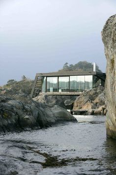 A Norwegian Summer Cabin Embraces the Rocky Terrain - Photo 1 of 10 -