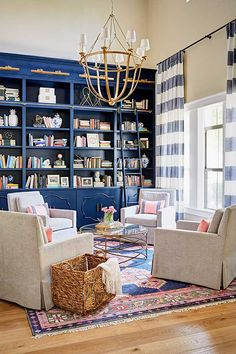 A blue built in bookcase is the perfect back drop for an intimate seating area.
