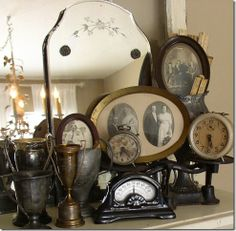 old silver and old photos and old mirrors- awesome! Doing a Vintage Theme. Vintage Vignettes, Vintage Antiques, Vintage Items, Vintage Clocks, Vintage Mantle, Vintage Display, Antique Decor, Antique Clocks, Vintage Frames