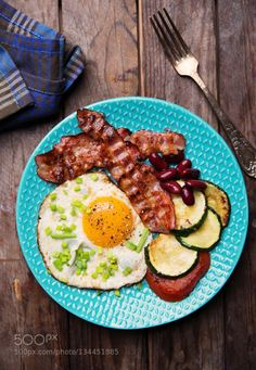 English Breakfast with fried eggs by lukawo  IFTTT 500px bacon breakfast egg eggs english breakfast food gourmet plate red bean tomato vegetabl