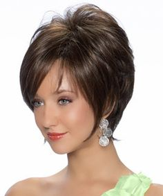 Kaylee by Tressallure is a classic wig that has great volume with tapered layers accentuated with long and wispy bangs. This style is made with high quality Japanese fibers. Designed by Noriko Suzuki,