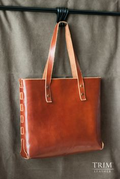 This handmade and hand dyed red sand tote bag will let you live it up as if you were in Hong Kong. Great way to carry the things you need in style!
