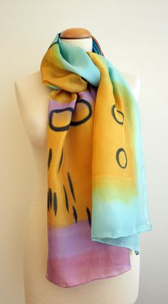 Handpainted Silk Scarf. Hand painted Silk Shawl. Add some wearable art to your outfit this season!  This is a beautiful hand painted silk scarf. This unique asbtract design is in some shades of yellow, blue, grey and other colors.  This will look great on you with any outfit, perfect for everyday wear or an elegant party or wedding.  Size: width: 180 cm = 71 inches height: 45 cm = 18 inches  Materials: Silk: ponge 8  Washing: I recommend to wash this scarf hand only, although you can use the…