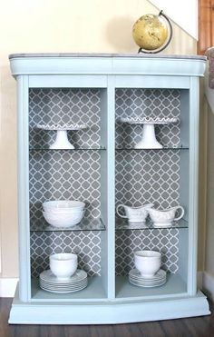 Entertainment Center Turned into a Bookcase -- Modernize that old entertainment unit into a chic bookcase  #decoartprojects