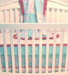 Persnickety Lily Matilda Bumper-less Crib Bedding: Persnickety Lily sells its crib sets as three pieces (skirt, sheet, and quilt) with the option of additional accessories. The retro aqua, pink, and berry Matilda set ($245) makes a colorful addition to a little one's room.