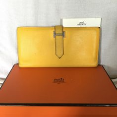 🚫SOLD🚫 Hermes Bearn Long Wallet yellow Authentic Hermes Bearn trifold wallet in  yellow (9V Jaune D'or) epsom leather. Much loved but inside is in good condition and has been storing in its original box...some loose threads... check all the photos....the pictures are accurate descriptions. This is authentic and retail value over $3000. Selling as is. I can certify authenticity before ship for $35. Price firm. Hermes Bags Wallets