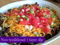 Great party appetizer you can make mostly ahead that will disappear in a flash.  Delicious non-traditional seven layer dip from Honest & Truly!