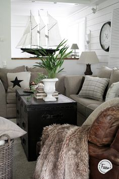 cozy living room with neutrals and leather seating