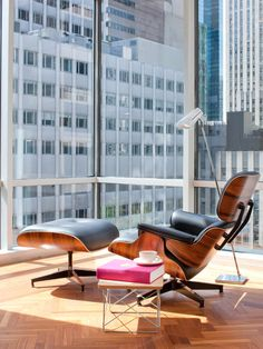 The Eames Lounge Chair and Ottoman from Herman Miller. Nice high-rise urban apartment setting.