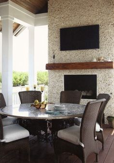Porch fireplace made of seashells. In Cottage Journal Magazine.
