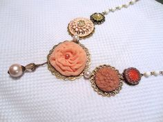 My most recent creation. A OOAK Peach flower necklace using LOTS of vintage goodies, $38, #wedding, #bride, #bridesmaid, #maidofhonor, #bridal, #peach, #Pink, #necklace, #flower, #Etsy, #vintage, #bronze, #chain, #glass, #buttons, #cabochon, #rosary, #crystal, #pendant, #pearl, #pearlized, #bead, #beads