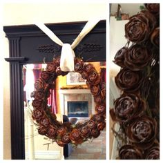 Pine cone tops on top of a twig wreath.