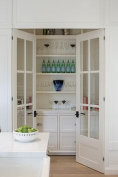 Pantry off kitchen with glass doors, open shelves, white marble countertop and lower cabinets with drawers Paint Color Benjamin Moore White Dove closet door ideas Glass Pantry Door, Pantry Room, Kitchen Pantry Cabinets, Kitchen Doors, Kitchen Countertops, New Kitchen, Glass Kitchen, Wall Pantry, Funny Kitchen