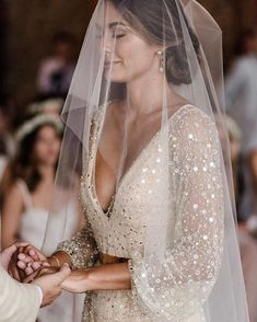 Low V cut wedding gown in champagne tone