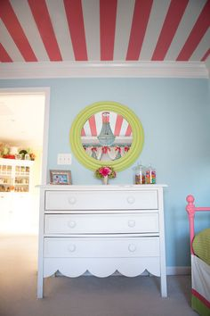 Lily Pulitzer pink aqua light green big girl room for Lou features peach stripes on ceiling and white dresser with light colored mirror