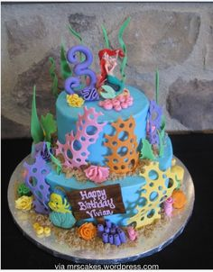 Love the shipwreck timber nameplate on this ariel cake