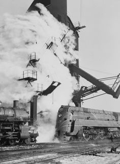 """Chicago, Illinois. One of the Chicago and North Western Railway's E-4 class """"400"""" fleet of locomotives lined up for coal and water at a coaling station. Photo: Jack Delano"""