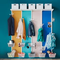 A clothes storage space in the hallway. baskets below for keys, phones, wallets