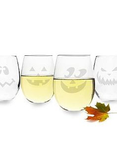 Give cocktail hour a macabre makeover this Halloween with the Set of Four Jack O Lantern Stemless Wine Glasses; complete with four frightening designs.