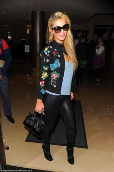 Paris Hilton wearing Yves Saint Laurent Patent Bow Bag in Black, Alaia Suede Ankle Boots and Alice + Olivia Felisa Bomber Jacket