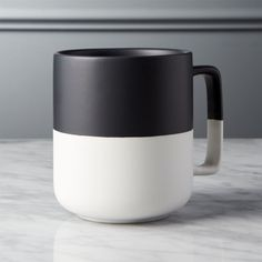 Shop Black Dip Large Mug. Demi-dipped in a matte black glaze, oversized mug with square handle exposes the natural clay base to graphic effect. Perfect for morning's first cup (and every cup after that). Serve with sweet and savory pastries on our Black Dip Platter.