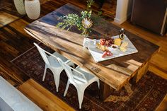 The Emmerson reclaimed wood dining table paired with white kitchen chairs looks modern and fresh!