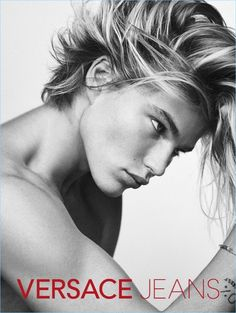 Jordan Barrett stirs up hair envy for Versace Jeans' spring-summer 2017 campaign.